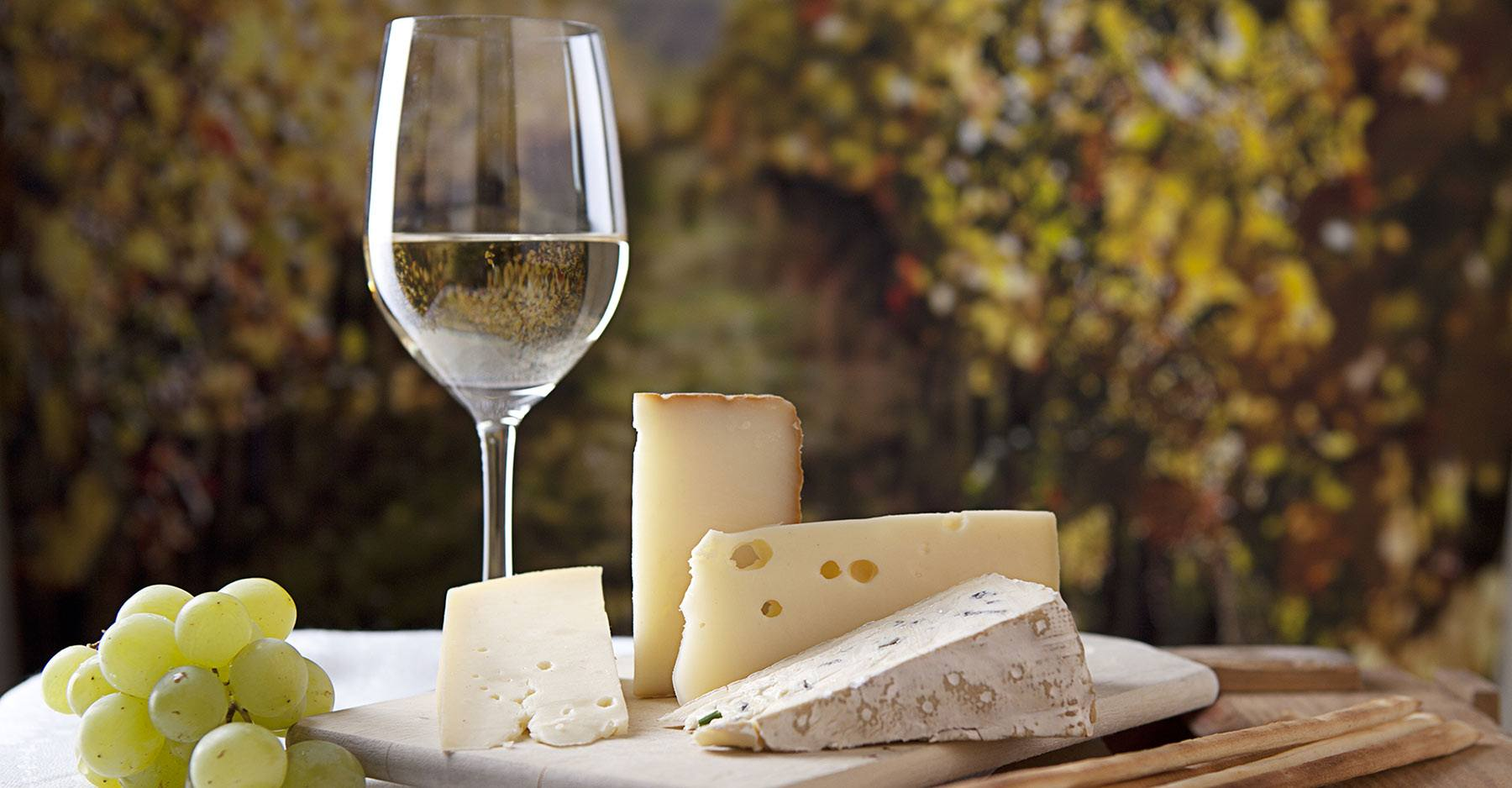 wine and cheese on a table