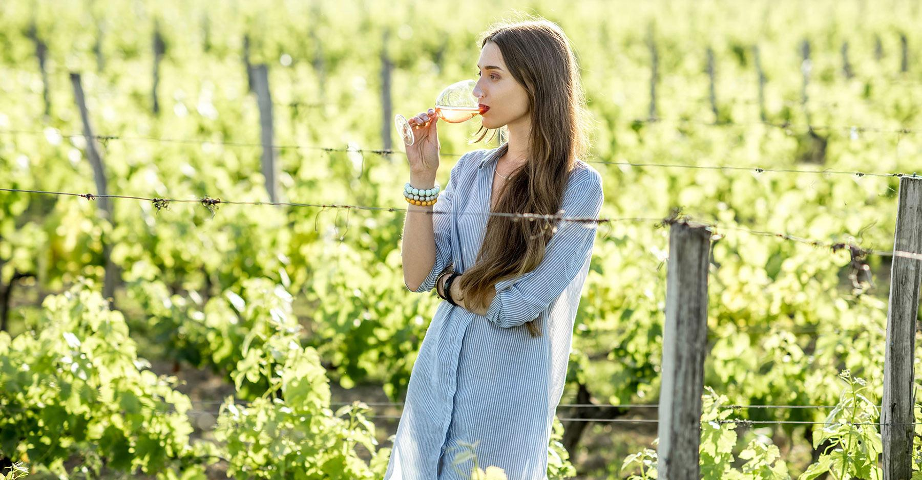 a woman in wineyards