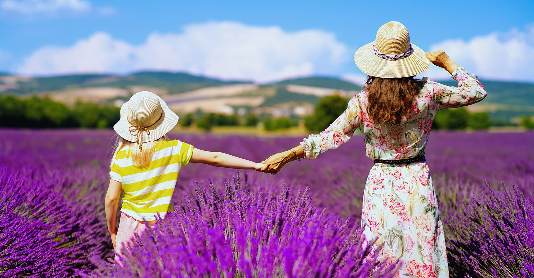 a litte girld and a woman into lavender fields