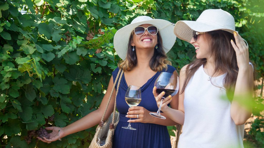 two women in wineyards